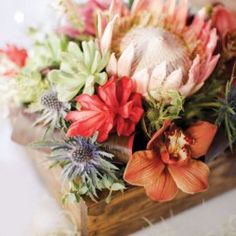 Protea centerpiece - love the box and the muted  sage & terra cotta colors