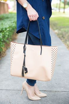 Lauren Ashley pairs her Perforated Shopper with nude pumps on TheFashionistasDiary.com