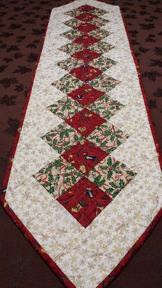 Get your home ready for the Holidays with this beautiful table runner. Red, green and gold, all the colors to reflect the Christmas spirit. The runner measures 60 long and 14 1/2 wide and would fit great on a dinning room table or a side board. 100% cotton Perfect for your Christmas