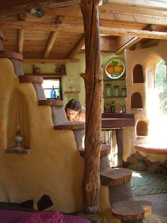 I've loved cob houses for a long time. They feel so natural, and look so comfortable. I luv the stairs on this and just the warmth the wood adds to it.