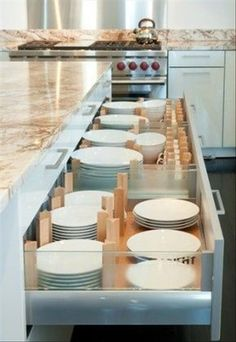 Dishware in kitchen drawers rather than the cabinets for a unique kitchen! #dishes #kitchenideas