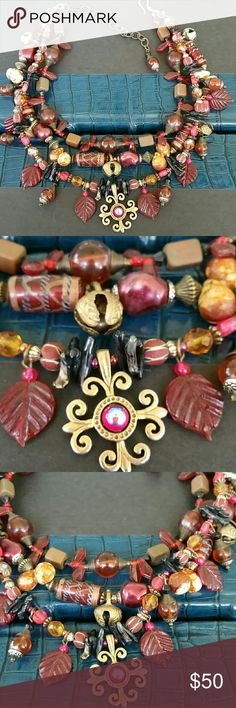 Necklace Gorgeous Boho Chic Multi colored Fushia Pink ,Wine, and Amber crystals Necklace purchased in fancy Boutique in Santa Fe... ABSOLUTELY BREATHTAKINGLY STUNNING! !!   WORN 3 TIMES TO PARTY!!! Jewelry Necklaces