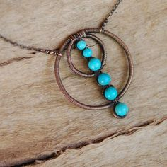 copper circles and turquoise necklace.