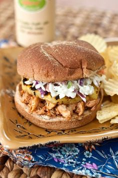 Hawaiian BBQ Chicken Sandwich    1 lb cooked, shredded chicken  1/2 cup barbeque sauce  1/4 cup pineapple juice  4 1/2″-thick slices of pineapple  4 King's Hawaiian hamburger buns  coleslaw, optional (recipe below)