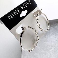 HP 12/31 Nine West Silver Hoop Earrings  NWT in box. Silver hoop earrings. Oval chain design. Clean and classy. Nine West Jewelry Earrings
