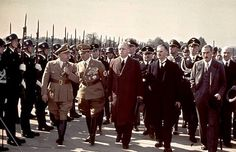 British Prime Minister Neville Chamberlain (front row, second right) walks past a Nazi honor guard on the way to a meeting with Adolf Hitler on September 28, 1938. We know how this turned out