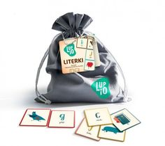 'Letters' game which helps children in learning the ABC. It consists of a little bag with cards decorated with pretty pictures.