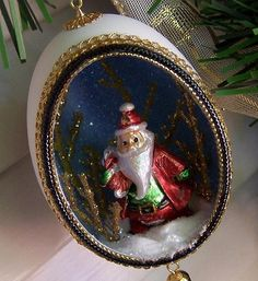 Ornament Santa ChristmasThis handmade ornament was created with a real duck eggshell that has been cut, trimmed, and glittered. Inside is Santa Claus heading out to make his deliveries! by EggShells for $14.00