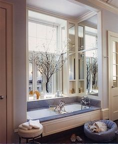 Beautiful detailing of the tub surround - mirrors, niches for soaps, all aligned with the windows...Fairfax & Sammons.