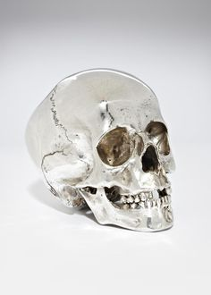 Spraypaint a skull decoration with chrome paint for a classier Halloween.