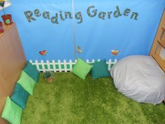 i like the name of this for my reading corner Book Corner Classroom, Reading Garden Classroom, Book Corner Eyfs, Reading Corner School, Preschool Reading Corner, Book Corner Ideas Preschool, Year 1 Classroom Layout, Book Corner Display, Future Classroom
