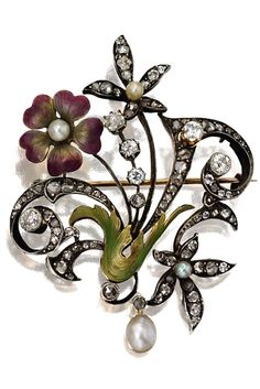 ART NOUVEAU DIAMOND AND ENAMEL PENDANT-BROOCH, CIRCA 1900. The stylized floral and foliate motif applied with translucent purple and green enamel, set with 6 old-mine and 84 rose-cut diamonds, accented further with 2 seed pearls and a pearl drop, mounted in gold and silver