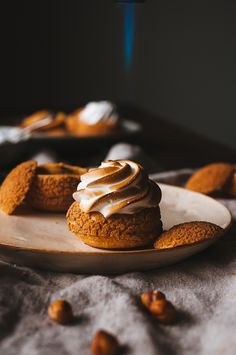 """sweetoothgirl: """" Caramelized Hazelnut and Toasted Marshmallow Cream Puffs """" Marshmallow Desserts, Marshmallow Cream, Toasted Marshmallow, Mini Desserts, Just Desserts, Delicious Desserts, Yummy Food, Healthy Food, Cream Puff Dessert"""