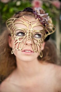 Butterfly leather mask in Gold. $39.00, via Etsy.