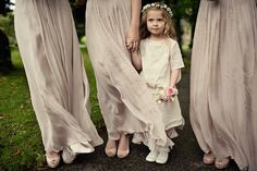 Flower girl in an embroidered dress + flower crown.