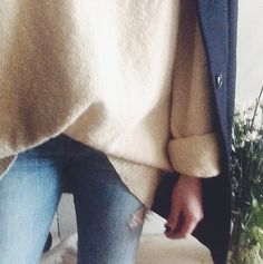 wearing oversized sweaters a lot lately.