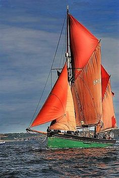 Trawler with well weathered sails....
