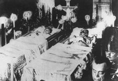 The bodies of Archduke Franz Ferdinand of Austria and his wife Sophie, Duchess of Hohenberg, lying in state after their assassination in Sarajevo; many consider their murders as the catalyst for the Great War.