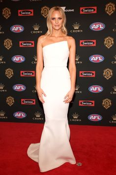 After a busy week of glitz and glamour for Australian sports, FEMAIL look at the sartorial successes and fashion faux pas of the Brownlow and Dally M Medals - so which came out on top? Strapless Dress Formal, Formal Dresses, Wedding Dresses, Julie Clark, Gq Men, Big Star, Red Carpet, Victoria, Glamour