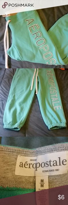 Aeropostale mint capri sweats Elastic waist and draw string with elastic bottom legs.  Mint green in color with the brand name on leg, good condition with some beading and a faint spot on the back. Size M. Aeropostale Pants Track Pants & Joggers