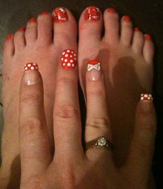My matching holiday hand and toe nails, coral and white poka dots with sparkle 3D bow on one finger