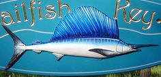 This vibrant summer home sign features a beautifully sculpted and painted sailfish. The text is incise carved and gilded. Lake House Signs, Fishing Signs, Fish Art, Home Signs, Key, Detail, Animals, Design, Animais