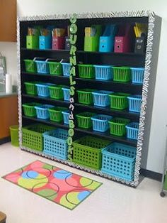 I like the use of bins and creates to store books and writing journals. This is a clean and organized way of keeping track of those things. Also I like the border along the bookshelf and the title in the middle. This is a very eye catching bookshelf and is appealing to young children. 6882