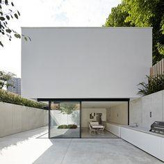 Sunken house by De Matos Ryan nestles in a secret garden