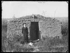 Pioneer schoolteacher Miss Mary Longfellow holding down a claim west of Broken Bow, Nebraska.