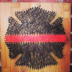 I saw this on Etsy.com but this is a #DIY project you can make at home. A #firefighter Maltese Cross on a piece of plywood with nails and string (or yarn) to make the cross. #MalteseCross