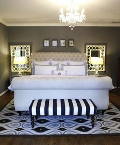 small master bedroom enlarged by matching mirrors and large rug completely under bed Beautiful