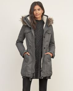 Womens A&F Sherpa Lined Military Parka   Military-inspired with sherpa lining throughout, made from water and wind resistant fabrication featuring fleece lined pockets, a cozy hood with removable faux fur, a button and zipper double closure, finished with a drawstring hem   Abercrombie.com