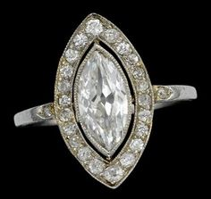 Art Deco platinum and diamond ring   Marquise cut diamond, approximately 1 carat, within pave diamond set marquise shape frame