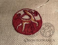 Oseberg textile Embroidery 12 B1 5.6x3cm The animals are placed back to back, with the heads facing each other Silk thread embroidery The frames were sewn with a bead-like seam Colors likely: Red-brown, brown, bronze and red This kind of naturalistic representation of animals in embroidery does not occur in Nordic art at this time The S-shaped volutes appear extensively in Irish and Anglo-Saxon manuscripts The motif with an animal figure in a circular beaded medallion is of oriental origin Nordic Art, Anglo Saxon, Brown Brown, Silk Thread, Lululemon Logo, Vikings, Irish, Oriental, Frames