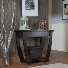 Add a unique flair to your decor with this gorgeous console-sofa table. This contemporary table is made of durable MDF and veneer, so it will last for many years. Its sleek look and curved legs will make this piece stand out in any space.