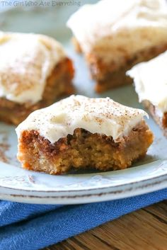 Cinnamon Roll Blondies - blondies with brown sugar and cinnamon swirled in and topped with cream cheese frosting. The yummy flavors of a cinnamon roll without the trouble of yeast. the-girl-who-ate-everything.com