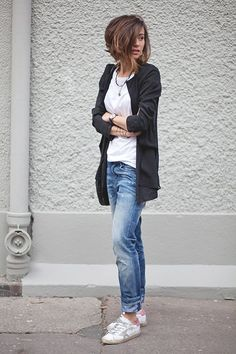 Zoé Alalouch illustrating the tomboy style perfectly with a pair of distressed denim jeans, an oversized black cardigan, plain white tee and sneakers Jeans: Meltin Pot, Cardigan: H&M, Tee: Petit Bateau, Shoes: Golden Goose