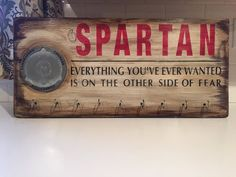 Are you proud of your Spartan race accomplishments? Do you want to show off all your hard work and dedication? Then this is the perfect way to display your medals! Sign Specifications:  Size: 24 X 11.25 Spartan race trifecta medal display 9 hooks for additional medals Wall hanging hardware preinstalled on the back  Color Choices for Spartan type:  Red Geen Blue Black  Materials:  Wood Acrylics Stain Chalk paint Wax Poly Acrylic