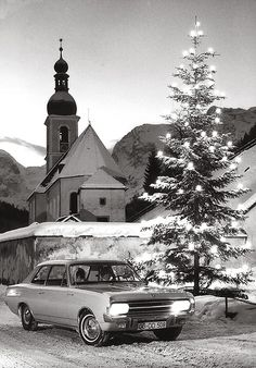 Ramsau revisited | 1967 Opel Rekord | I found yet another Opel photo that took the famous church of Ramsau near Berchtesgaden in Bavaria as a backdrop.  But why does that woman at the wheel look so grumpy? And why no whitewall in the rear tire on an official Opel photo?
