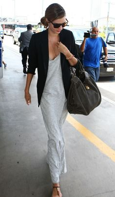 Miranda Kerr in a light grey maxi and black jacket | streetstyle | Effortless