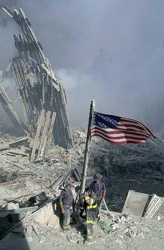 Firefighters raising the flag after 9-11.