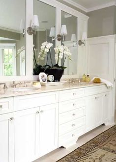 I love the idea of taking a big hunk of mirror and adding molding to make it seem like more mirrors. Looks like a beautiful furniture piece, not a dreadful slab thrown on the wall.