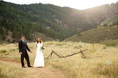 """This amazing couple decided to host their rustic outdoor wedding in the mountains of Colorado and by what we can see with these images we agree with their decision. Taking place at Lorty State Parkthis rustic wedding had a beautiful outdoor ceremony with the natural beauty as its backdrop. With light pink bridesmaid dresses and a simple wedding arch this couple said """"I do"""" in true rustic chic fashion. Thanks toLindsay J. C. Lack – Photojournalistfor sharing this wedding with us today…"""