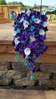 Galaxy orchid cascading bridal bouquet purple blue orchids image 2 This beautiful bridal bouquet is made with hand painted galaxy orchids, turquoise hydrangeas and real touch faux calla lilies. The bouquet is accented with pearls and rhinestones. Calla Lily Bridal Bouquet, Cascading Wedding Bouquets, Bridal Bouquet Fall, Flower Bouquet Wedding, Blue Orchid Bouquet, Bridal Flowers, Blue Orchid Wedding, Peacock Wedding, Orchid Images