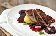 Duck breast on beetroot chutney with summer fruits, jelly and raspberry balsamic