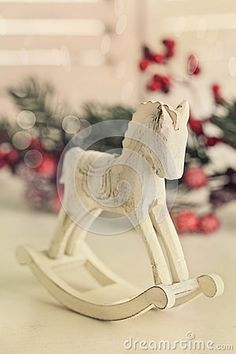 Wooden rocking horse on white table