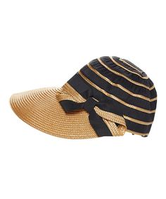1c1482d2b62 Shade yourself from the sun in chic style with this hat that sports a  generous brim and a romantic bow accent.