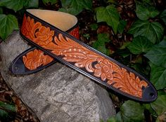 One of  our custom order guitar strap projects for David Greenwell of Valleys Guitars, Australia.  Hand-tooled leather, hand-painted background
