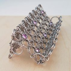 Chainmaille Business Card Holder with captured Swarovski crystals by Lisa Ellis. Tutorial available at https://lisaellis.selz.com