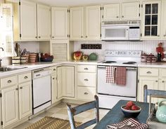 I am in search of some pictures and suggestions for a beautiful kitchen. My current kitchen is a colonial galley style with linoleum floors/oak cabinets/formica countertops/white appliances. I would like to keep the white appliances because they are relatively new. I am open to painting my cabinets ...